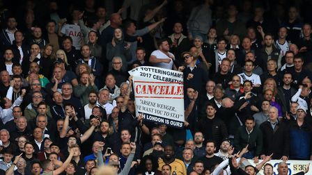 Tottenham Hotspur fans hold up a banner during the North London derby against Arsenal at White Hart