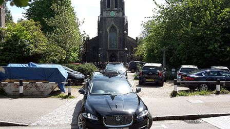 Mourners follow the convoy of cars as they leave St Michael's Church. Picture: Declan Warrington/PA