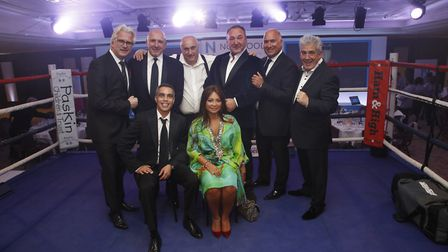 The Boxing Dinner committee pose in the ring