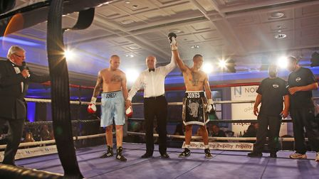 The winner is announced for one of the three rounds of boxing.