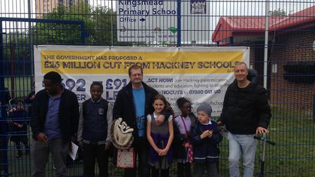 A banner was unveiled outside Kingsmead Primary School on Monday afternoon protesting against the cu