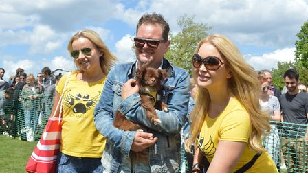 Celebrity judge and Patron of organisers All Dogs Matter Alan Carr presents The Canine Angels rescue
