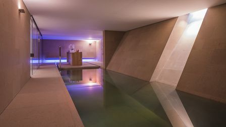 The property features an indoor swimming pool, sauna and steam room