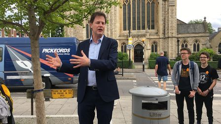Nick Clegg delivering a speech outside Planet Organic as young Liberal Democrat supporters look on.