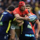 Saracens' Schalk Brits (centre) is tackled by Clermont Auvergne's Benjamin Kayser (right) and Etienn