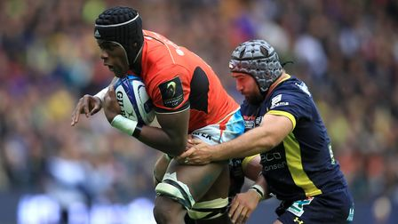 Saracen's Maro Itoje (left) is tackled during the European Champions Cup final (pic Mike Egerton/PA)