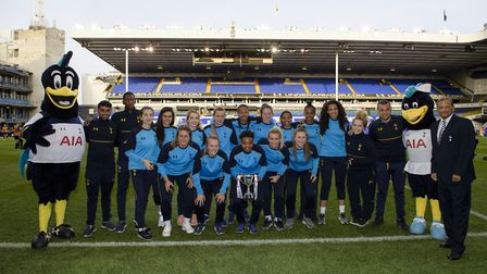 Tottenham Ladies Reserves celebrate with their silverware at White Hart Lane (pic wusphotography.com