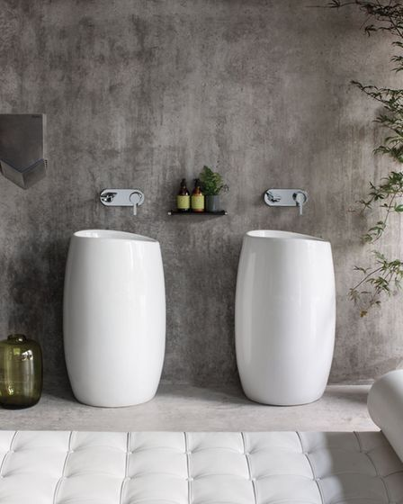 Ombrone Totem basin, £1,190.25; Ciane wall mounted basin mixer, £250.13, both available from Sottini