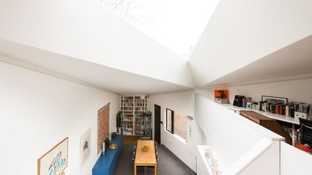 The triangular home at Otts Yard features a similarly three sided rooflight