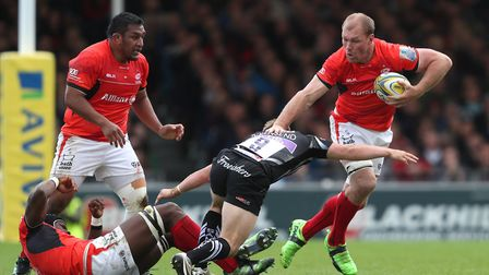 Saracens' Schalk Burger (right) is tackled by Exeter Chief's Stu Townsend (pic: David Davies/PA Imag
