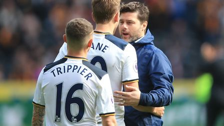 Tottenham Hotspur manager Mauricio Pochettino with Harry Kane (Centre) after the final whistle at Hu