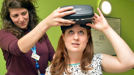 Danielle Wilde, Trust Dementia Lead at the RFH puts the virtual reality headset in place. Photo: Pol