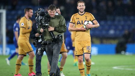 Tottenham Hotspur's Harry Kane walks off with the match ball after scoring four times at Leicester (