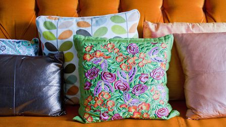 Even the cushions are on board with the botanical theme