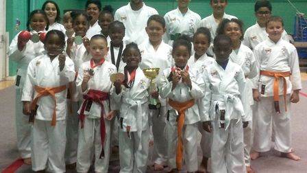 Hackney's Olympic Karate Inc face the camera with their medals