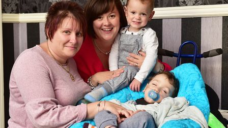 Parents Aimee and Kirstie Messenger with Cohen and Ethan during the fundraising campaign for Cohen's