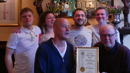 Marcus Grant (left), Steve Barnes (right) and some of the Wenlock pub's team celebrating their succe