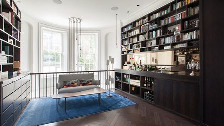 5 Regents Park Road was once home to Martin Amis, and features floor to ceiling bookshelves