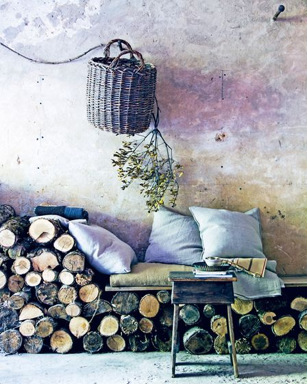 The sofa made from a stack of logs, a plank and a mattress at home of Hans Blomquist featured in boo