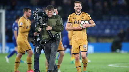 Tottenham Hotspur's Harry Kane thanks the fans holding the match ball after the final whistle agains