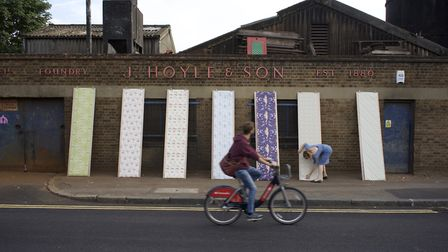 Angela Groundwater with her bespoke wallpaper designs at her studio in Bethnal Green