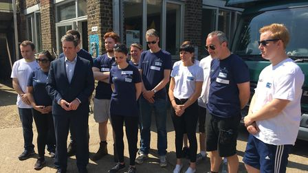 Keir Starmer with volunteers observing a minute's silence for the victims of the Manchester. Pictu