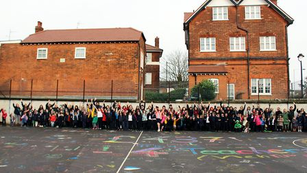 St Michael's Primary School creating a piece of artwork in protest to funding cuts earlier this year