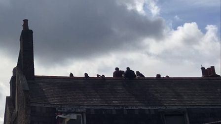 The ravers were seen on the roof of the 300-year-old building the following morning.