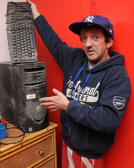 Edward Davies with damaged electricals at his Hanmer Walk flat on the Andover Estate. He has a sever