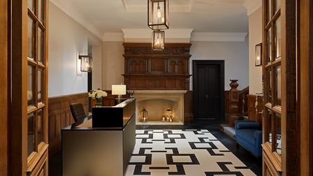 The original entrance hall in Otto Schiff House retains its ornate fireplace, now alongside the new