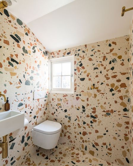 The guest WC and wet room is clad in �Marmoreal� terrazzo by Dzek and Max Lamb