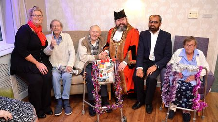 Peter Knight, Farooq Patel and Joy Henshaw with Dell Care Home residents in their new lounge at the