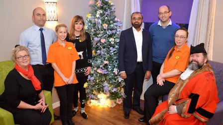 Deputy Mayor, Dell Care Home staff and management gather around the Christmas tree at the Dell Resid