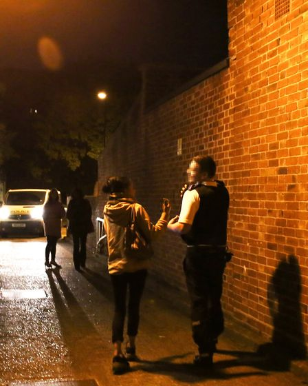 Police officer Charlie talks to a known prostitute while on vice patrol. Picture: Catherine Davison
