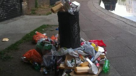 An overflowing bin on a towpath in Camden. The Canal and Rivers Trust are removing bins along canals
