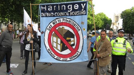 Nick Martin-Clark (right) and members of the Haringey Leaseholders' Association have claimed victory