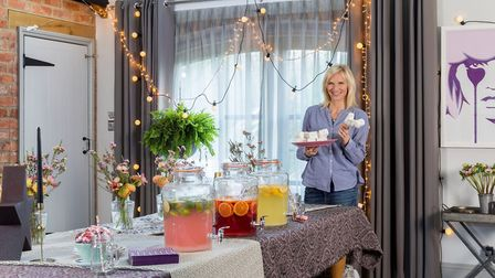 Jo Whiley in the kitchen of her Northamptonshire home, with a table decorated in festival/party styl