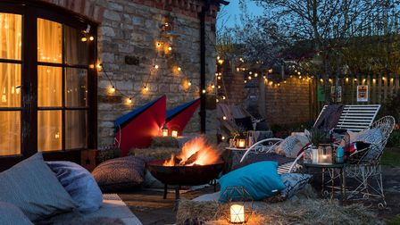 Jo Whiley's home decorated with a hand-made Ziggy Stardust lightning bolt sign, fairy lights, a fire