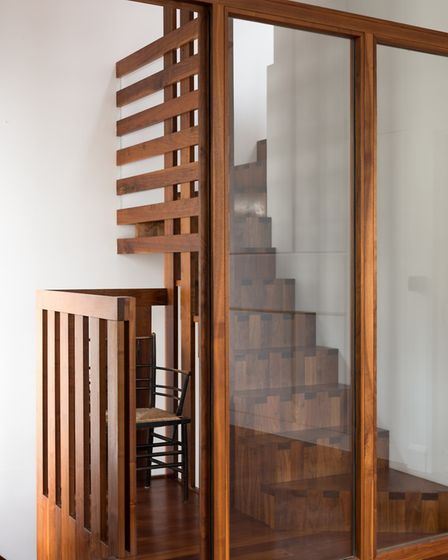 The stunning feature staircase is made from finger-jointed black walnut from America