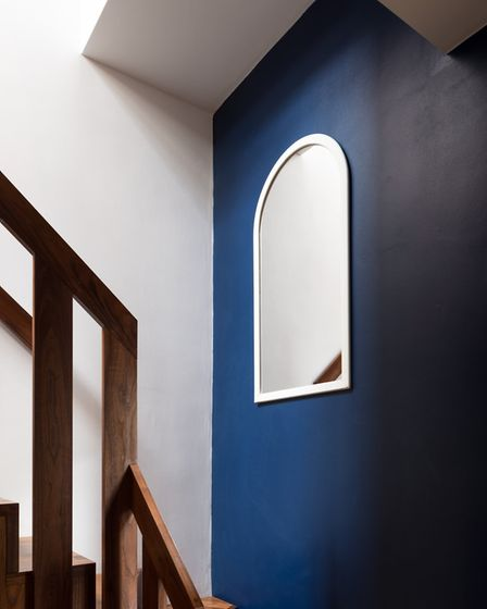Redhill Place was built in 1912 and is bathed in deep tones from royal blue to racing green