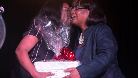 Stephanie Ozuo presents Diane Abbott with a hamper during the MP's 'appreciation night' at the Queen