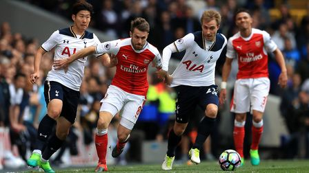 Tottenham Hotspur's Christian Eriksen and Arsenal's Aaron Ramsey battle for the ball at White Hart L