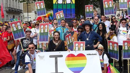People marching with Hackney Council at last year's Pride, with the banner created by street artist