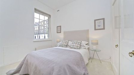 An inviting bed made up with crisp and fresh linen is a must