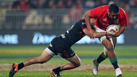 British and Irish Lions' Mako Vunipola is tackled by Crusaders' David Kaetau Havili during the tour