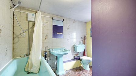 The spearmint blue three piece bathroom suite is certainly eyecatching, but could do with a spruce u