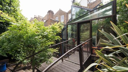 A modern gothic feature, a balcony with metal balustrade which once ran over a moat