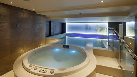 The indoor pool at Gisiana House will have you feeling like you're in Thailand with a wall display a