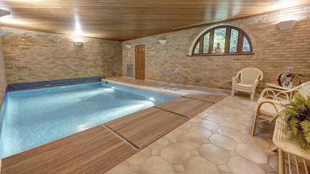 The indoor pool at 9 Westover Hill offers a sheltered place for an active swim when drizzly days dam