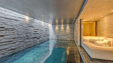 A luxurious lounging area lines the pool at Holford Road which measures just under 60 sq m.